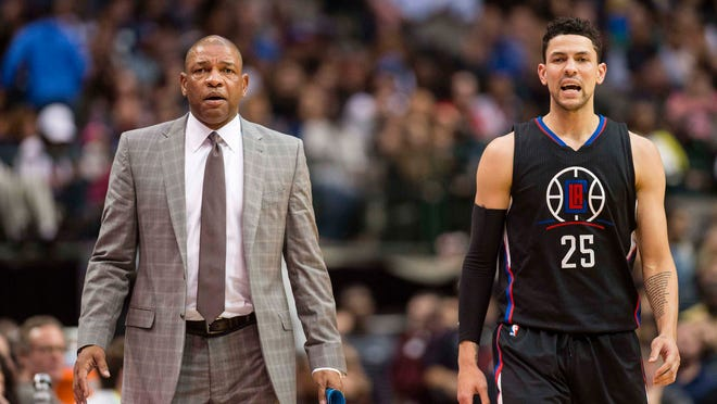Nov 23, 2016; Dallas, TX, USA; LA Clippers head coach Doc Rivers and guard Austin Rivers (25) yell at the referees during the second half against the Dallas Mavericks at the American Airlines Center. The Clippers defeat the Mavericks 124-104. Mandatory Credit: Jerome Miron-USA TODAY Sports ORG XMIT: USATSI-323796 ORIG FILE ID:  20161123_ggw_an4_273.JPG