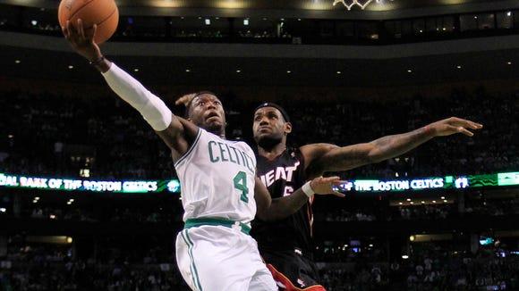 Boston Celtics guard Nate Robinson, left, drives to
