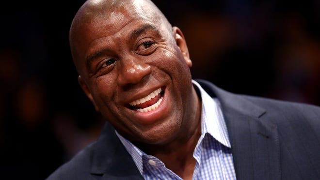 Los Angeles Lakers Hall of Fame player and current part owner of the Los Angeles Dodgers Magic Johnson attends the game with the Dallas Mavericks at Staples Center on October 30, 2012 in Los Angeles, California.  The Mavericks won 99-91.  NOTE TO USER: User expressly acknowledges and agrees that, by downloading and or using this photograph, User is consenting to the terms and conditions of the Getty Images License Agreement.