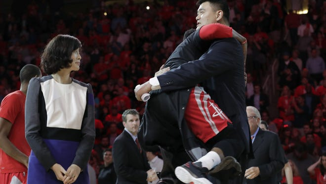Yao Ming smiles as James Harden #13 of the Houston Rockets jumps into his arms after the jersey reitrement ceremony during the game between the Houston Rockets and the Chicago Bulls at Toyota Center on February 3, 2017 in Houston, Texas. NOTE TO USER: User expressly acknowledges and agrees that, by downloading and or using this photograph, User is consenting to the terms and conditions of the Getty Images License Agreement.