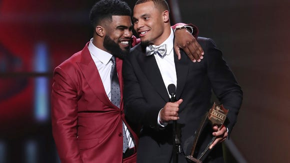 IMAGE DISTRIBUTED FOR NFL - Ezekiel Elliott, left, and Dak Prescott of the Dallas Cowboys accept their award for AP Offensive Rookie of the Year at the 6th annual NFL Honors at the Wortham Center on Saturday, Feb. 4, 2017, in Houston. (Photo by John Salangsang/Invision for NFL/AP Images) ORG XMIT: CABR177