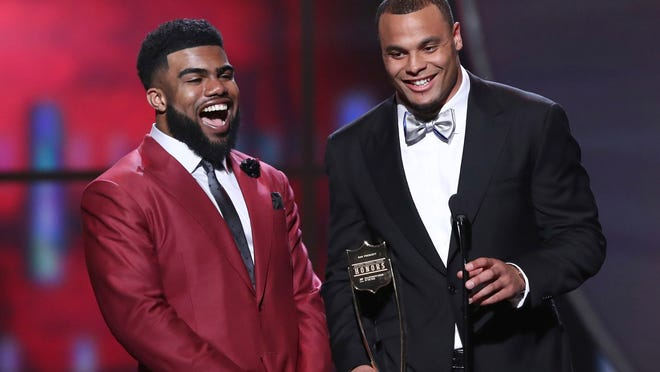 IMAGE DISTRIBUTED FOR NFL - Ezekiel Elliott, left, and Dak Prescott of the Dallas Cowboys accept their award for AP Offensive Rookie of the Year at the 6th annual NFL Honors at the Wortham Center on Saturday, Feb. 4, 2017, in Houston. (Photo by John Salangsang/Invision for NFL/AP Images) ORG XMIT: CABR101