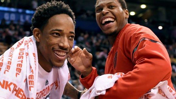 Toronto Raptors guard DeMar DeRozan, left, and guard