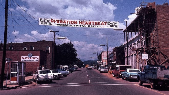 Franklin Mayor Bob Scott says in 1971 the community raised money to save Angel Medical Center. This photo shows a banner that was hanging at the time. Recent news about changes planned by Mission Health have upset the community.