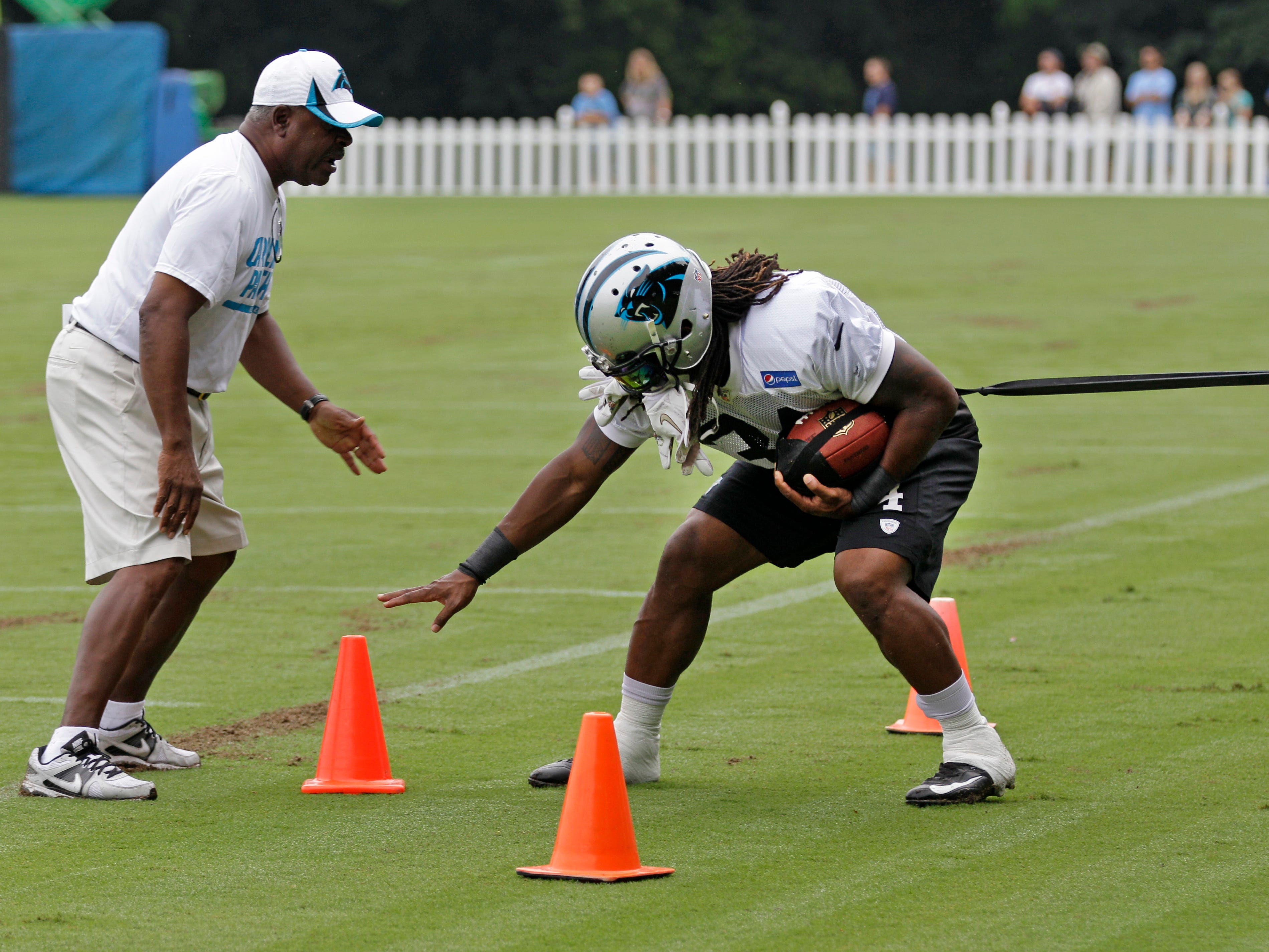 Panthers RB DeAngelo Williams goes through a drill Aug. 7.