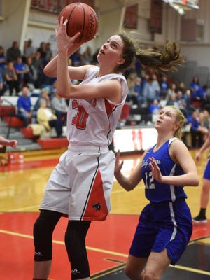 Norfork's Marleigh Dodson goes up for two during the Lady Panthers' 88-59 victory over Mammoth Spring on Thursday night. Dodson topped the 2,000 career point mark on Tuesday night, scoring 29, and followed it up with 27 more on Thursday.
