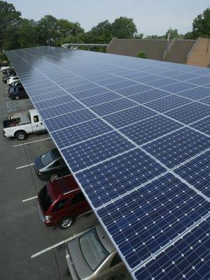 Solar panels rest on a car port just beyond the Aberdeen Township Municipal Building.