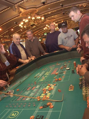 Patrons play craps at the Grand Victoria Casino (now the Rising Star Casino in Rising Sun, Indiana) in 2006.
