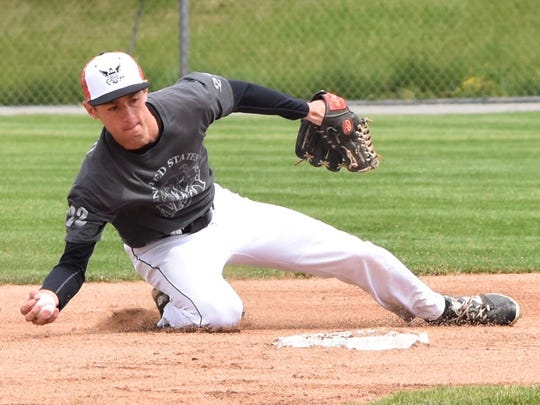 Northville shortstop Kevin Morrissey makes the bare-handed grab at second base on Armed Forces Day.