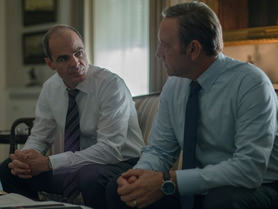 Michael Kelly, left,  as Doug Stamper and Kevin Spacey