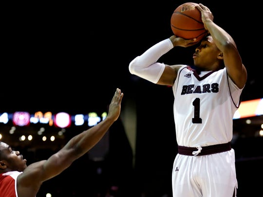 Missouri State's Mustafa Lawrence shoots a three-pointer