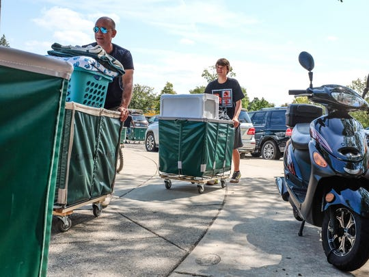 MSU students can move into their residence halls by the end of this month. Students who join the university's Welcome Team can move in early and get free food.