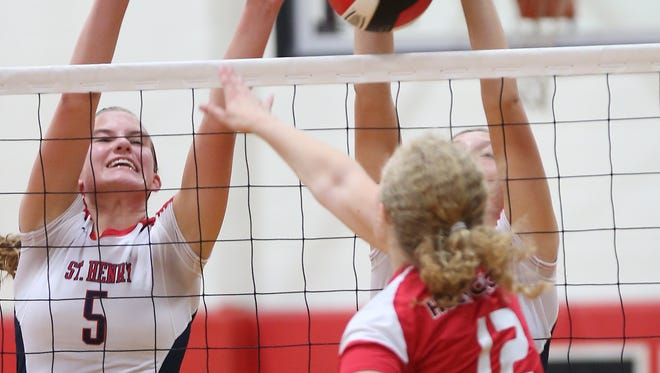 """State tournament MVP Janelle Tobler (5) leads St. Henry into Saturday's Touchstone Energy All """"A"""" Classic state volleyball tournament at Louisville's Basketball Academy."""