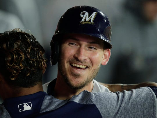 Milwaukee Brewers' Yasmani Grandal celebrates his home run with a teammate during the fifth inning of a baseball game against the Los Angeles Angels, Tuesday, April 9, 2019, in Anaheim, Calif. (AP Photo/Jae C. Hong)