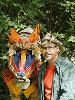 Artist Dale Teachout with his baboon creation that is part of the exhibit, The Zoo, Thursday, June 4, 2015, at the Art Museum of Greater Lafayette. The Zoo features 22 pieces created by Teachout using items found along curbsides. Teachout said it took him three and a half months to create the animals in the exhibit.