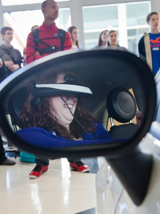 """Senior student Paige Gross virtually crashes her car while texting at Central York High School Friday, March 8, 2013. AT&T and Peers Awareness develop the Texting and Driving Simulator for teenagers to get hands on experience while distracted on the road. """"Its a juggle to do everything,"""" said Gross. DAILY RECORD/SUNDAY NEWS - SONYA PACLOB"""