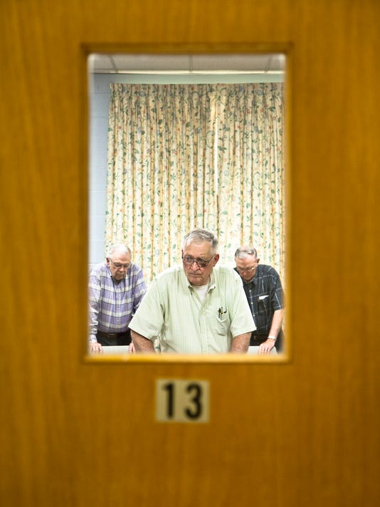 Don Neiman, center tells the Parkinson's patients to stand behind chairs for balance.  DAILY RECORD / SUNDAY NEWS - SONYA PACLOB