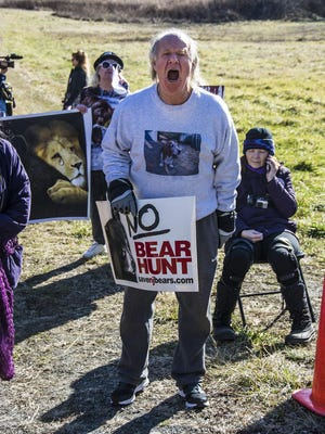 In this file photo taken on December 7, 2015, Jerome Mandel of Newton protests at the state's annual black bear hunt at the Whittingham Wildlife Management Area in Newton.