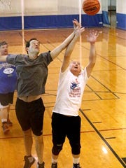 Omri Rawlins, 77, plays a game of basketball at the