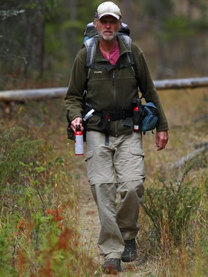 Tim Rubbert believes making adequate noise while hiking is the best way to avoid a surprise encounter with a grizzly bear, which is the cause of most maulings, and he urges all hikers to carry bear spray. Rubbert always hikes with two cans of bear spray on his pack belt, and he often carries one can in his hand with the safety off when he is hiking alone or hiking in areas with limited visibility.