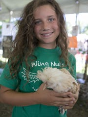 Wing Nuts 4-H club member Lilah Ficuciello, 8, of Morris Plains, holds a mixed bantam pullet she raised at Fosterfields though the club. The Morris County 4-H Fair is held through Sunday at Chubb Park, Chester, NJ. Saturday, July 23, 2016.