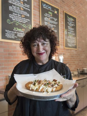 Restaurant owners Elaine Dakessian, pictured, and Sue Sa have opened Left of Center at 699 W. Center Ave. Pictured is their flatbread.