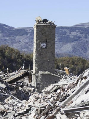 The bell tower of Amatrice, central Italy, which stood standing after the Aug. 24, 2016 earthquake, is seen with its top part collapsed after an earthquake with a preliminary magnitude of 6.6 struck central Italy, Sunday, Oct. 30, 2016. A powerful earthquake rocked the same area of central and southern Italy hit by quake in August and a pair of aftershocks last week, sending already quake-damaged buildings crumbling after a week of temblors that have left thousands homeless.