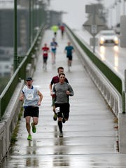 Bremerton Marathoners cross a wet Manette Bridge on Sept. 17, 2016.