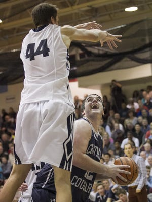Randolph center Luke Nathan tries to block Chatham senior forward Graham LeMon's shot during a Morris County Tournament semifinal.