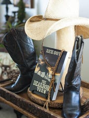 "A hat and boot display frames Rick Goff's recently published novel, ""The Dearborn Yarn,"" on Monday."