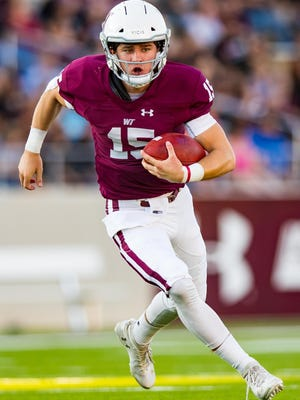 West Texas A&M quarterback Nick Gerber  runs the ball against Western New Mexico on Sept. 28, 2019, at Buffalo Stadium. Gerber will return for his junior season to play five games for the Buffs this fall.