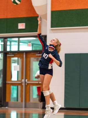 Wimberley's Holly Harwood serves for the Texans during their three-set win over Gateway Prep last week. Harwood notched eight kills and seven aces in the victory.