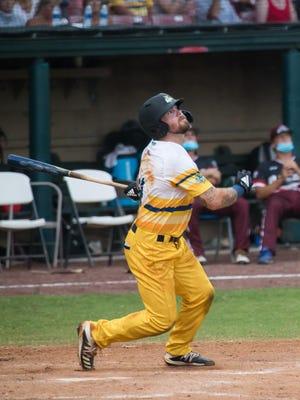 Savannah Bananas outfielder Logan Foster follows through on a hit during a recent game at  Grayson Stadium.