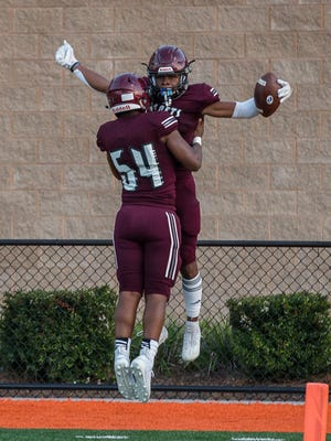 Benedictine's Za'Quan Bryan celebrates in the end zone with teammate Brian Johnson after scoring a touchdown during Friday night's season opener against Burke County at Memorial Stadium. Benedictine won 58-26.