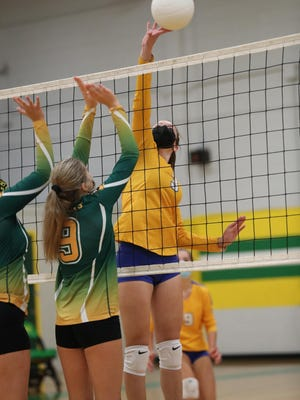 Highland's Whitney Whitesides tips the ball over the net against Bessemer City in Tuesday's match, opening up the high school volleyball season.