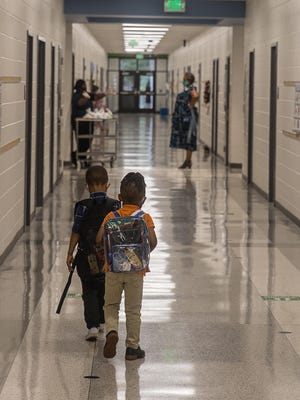 Young students make their way down the hallway on Monday during the first day of Phase III Hybrid Learning at White Bluff Elementary. Today was the first day that more students were welcomed back to in-person learning.