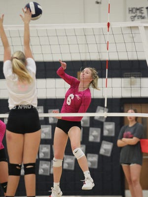East Gaston's Maddie Miller returns a shot across the net against South Point last year in volleyball action.