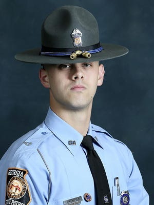 In this undated photo released by the Georgia Department of Public Safety, State trooper Jacob Gordon Thompson is seen in an official portrait.  The Georgia Bureau of Investigation said in a statement Friday, Aug. 14, 2020 that 27-year-old Thompson was charged with felony murder and aggravated assault.  The trooper has been fired and charged with murder a week after he fatally shot a 60-year-old man who attempted to flee a traffic stop. (Georgia Department of Public Safety via AP