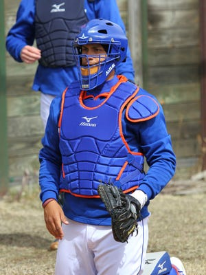 Binghamton Mets catcher Xorge Carillo is bundled up during a bullpen session at NYSEG Stadium prior to the start of the 2014 season.