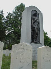 Memorials and grave sites for Confederate States Army soldiers buried at Woodlawn National Cemetery.