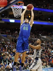 Senior Chase Fieler helped turn FGCU into Dunk City last season. Kinfay Moroti / The News-Press FGCU's Chase Fieler dunks over a Georgetown defender Friday night at the Wells Fargo Center. FGCU won 78 to 68.