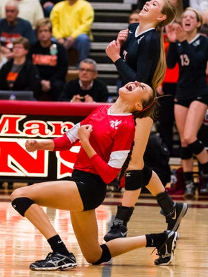 City High's Ashley Smith (1) and Alexa Aldrich-Ingram (3) celebrate a score in the second game at Linn-Mar High School in Marion Tuesday, November 4, 2014.