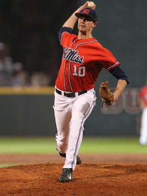 Ole Miss pitcher Chris Ellis winds up to throw a pitch in the Rebels' first game of the series against Mississippi State in Starkville. Photo by Kevin Warren
