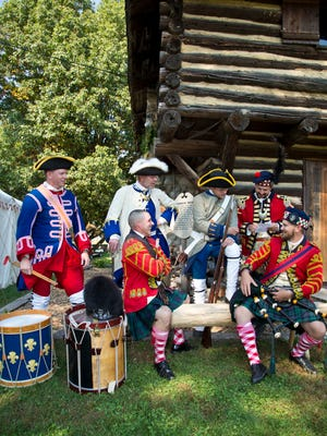 John Satterly, standing from left, John Howland, William Brand and Preston Smith, and, sitting, B.J. McAllister, left, and Taylor Stirm at Fort Ouiatenon near West Lafayette. The men are members of the Tippecanoe Ancient Fife and Drum Corps and the 42nd Royal Highlanders.