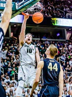 MSU's Matt Costello dunks the ball over Purdue's Isaac Haas to put MSU up 56-44 late in a critical win on March 4. Costello had 13 points, seven rebounds and four blocks in the game.