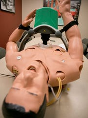 The LUCAS 2 Compression System performs CPR that has been newly acquired at the Marshfield Fire Department, Wednesday, March 11, 2015.