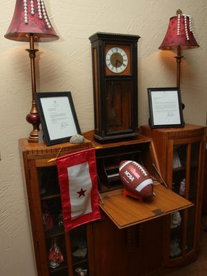 A display at the home of Palm Springs residents Mike and Kathleen Potts includes a letter from Vice President Joe Biden and a football which will be signed by the 21 Marines coming to the Potts' home for Thanksgiving dinner. Photographed on Monday, November 24, 2014.