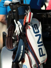 """The strap of Chad Pfeifer's golf bag is imprinted with """"Home of the Brave"""" as seen as he drives a cart between holes at the Palmer Private Course at PGA West during the opening round of the Humana Challenge on Thursday, January 22, 2015 in La Quinta, Calif. Pfeifer is an Operation Iraqi Freedom veteran who lost part of his left leg during an IED blast. He learned to play golf while recovering from his injuries and has since become a scratch golfer."""