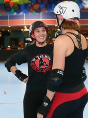 V Town Roller Derby Dame Breanna Bergdorf (Bergie Nites-#240), left, visits with teammate Rhonda Mayer (Clock Cleaner #357) during practice at Roller Towne in Visalia.