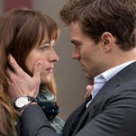 "Dakota Johnson and and Jamie Dornan in ""Fifty Shades of Grey."""